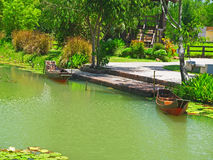 Boats in a garden. Royalty Free Stock Photos