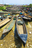 Boats gathered for market in Myanmar. Nyaungshwe, Myanmar - April 2016: Many boats gathered for Nam Pan outdoor market on Lake Inle. Many people are visible as Royalty Free Stock Photos