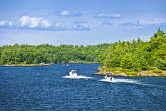 Boats on Georgian Bay. Recreational boats on blue waters of Georgian Bay near Parry Sound, Ontario Canada royalty free stock photography