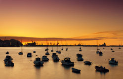 Boats in Getxo port at sunset Stock Photography