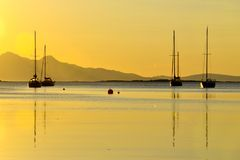 Boats in a golden coastal sunset, Arisaig Royalty Free Stock Photography