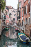 Boats & Gondola down a street canal off the Grand Canal in Venice, Italy Stock Photo