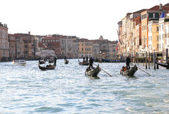 Boats and gondolas with many tourists sailing on the Grand canal Royalty Free Stock Images