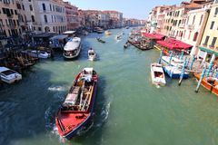 Boats on the Grand Canal in Venice, Italy. Gondolas, public boats, water taxis and other private boats navigating the Grand Canal in Venice, Italy on September Royalty Free Stock Image