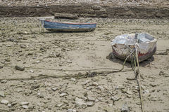 Boats on ground during tide Royalty Free Stock Images