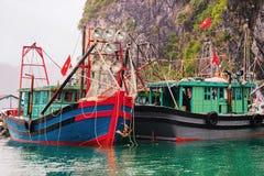 Boats at Ha Long Bay Vietnam. Boats at Ha Long Bay, Vietnam. Limestone islands on the background royalty free stock images