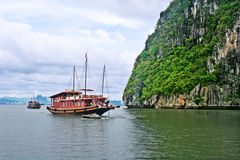 Boats at Halong Bay. Limestone outcrops in Ha Long Bay and tourist boat Royalty Free Stock Photo