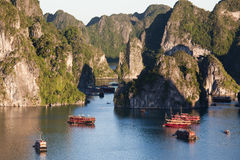 Boats in Halong Bay, Vietnam. Between rocky limestone isles is a UNESCO World Heritage Site Stock Image
