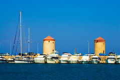 Boats in a harbor. Boats in the Rhodes harbor. Greece Royalty Free Stock Photography