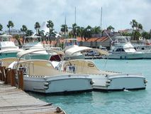 Boats in the harbor of Aruba in the Caribbean Stock Images
