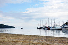 Boats in the harbor and beach Stock Photography
