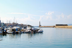 Boats in harbor of Greece. Boat anchored in venetian harbor, Chania, Greece Stock Image