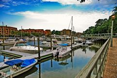 Boats at Harbor on Hilton Head Island. Motor boats and sailboats docked at the marina waiting for a clear day for sailing and fishing royalty free stock photo