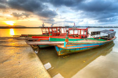 Boats on the harbor of Koh Kho Khao island. Sunrise at the harbor of Koh Kho Khao island, Thailand Stock Photo