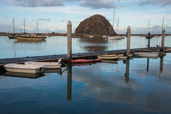 Boats in Harbor. Boats moored anchored and docked in Morro Bay around Rock royalty free stock photos