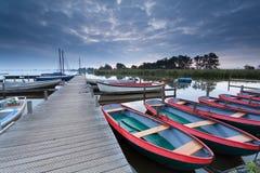 Boats at harbor in morning Royalty Free Stock Image