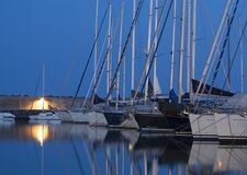 Boats in harbor at night Stock Photo