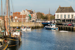 Boats in harbor of old town of Harlingen, Netherlands Stock Image
