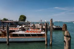 Boats from the harbor in Punta Sabbioni to Venice in Italy royalty free stock image
