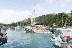 Boats in the harbor of Seychelles. La Digue, Seychelles - August 12, 2015: many ships in la Digue island port, Seychelles Royalty Free Stock Photos