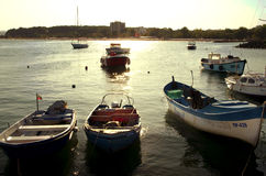 Boats in the harbor on sunset Stock Images