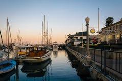 Boats in the harbor at sunset, in Santa Barbara, California. Stock Photos