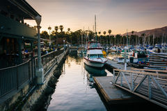 Boats in the harbor at sunset, in Santa Barbara, California. Royalty Free Stock Images