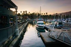 Boats in the harbor at sunset, in Santa Barbara, California. Royalty Free Stock Images