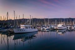Boats in the harbor at sunset, in Santa Barbara, California. Royalty Free Stock Photography