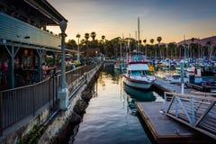 Boats in the harbor at sunset, in Santa Barbara, California. Stock Photo