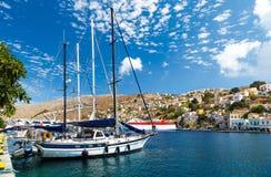 Boats in the harbor of Symi Island. Greece, Europe Stock Photo