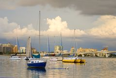 Boats in Harbor Under Cloudy Skies Royalty Free Stock Photo