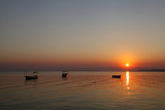 Boats harbored at Busaiteen beach during dawn Royalty Free Stock Photos