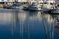 Boats in harbour. Boats parked in a harbour, water reflection Royalty Free Stock Photo