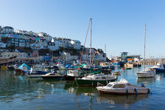 Boats in harbour Brixham Devon England during the heatwave of Summer 2013. Brixham harbour Devon England with boats on a calm day with blue sky during the Royalty Free Stock Photo