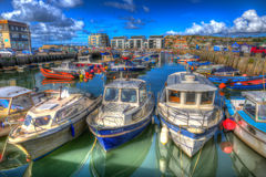 Boats in harbour with cloudscape West bay Dorset England UK on calm summer day Royalty Free Stock Images