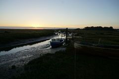Boats in Harbour. Early morning at Thornham harbour Stock Photos