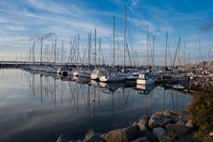 Boats in the harbour in the evening sun Royalty Free Stock Photography