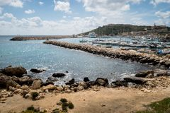 Mgarr Harbour view on a cloudy day. Boats in Mgarr harbour royalty free stock photo