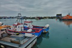 Boats in the harbour of Howth stock photos