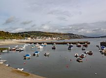Boats in the harbour at Lyme Regis in Dorset, England royalty free stock photo