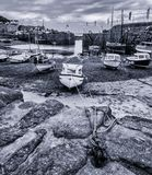 Boats in harbour at Mousehole,Cornwall at low tide Royalty Free Stock Photography