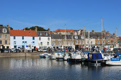 Boats in harbour, seafront shops, Anstruther, Fife Stock Image