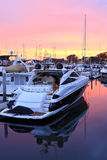 Boats in harbour at sunset Royalty Free Stock Image