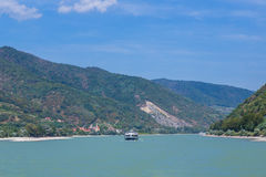 Boats, hills, wineries in the Wachau Valley. WACHAU VALLEY, AUSTRIA - 28TH AUGUST 2015: Boats along the River Danube in the Wachau Valley. Hills and wineries and Stock Photography