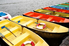 Boats hire. Colorful recreation boats in a row at river Stock Photography
