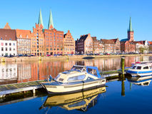 Boats and Historic buildings at Trave river, old town of Lubeck. Germany Royalty Free Stock Photography