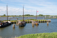 Boats in historic harbour of fortified town of Woudrichem, Nethe Stock Photography