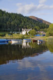 Boats and house loch Lomond Royalty Free Stock Photos