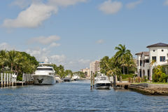 Boats and houses on canal Royalty Free Stock Photo